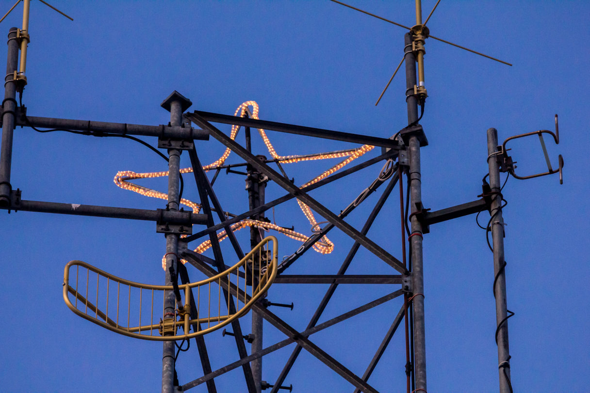 The KNOM Christmas star atop the station's FM transmitter tower.