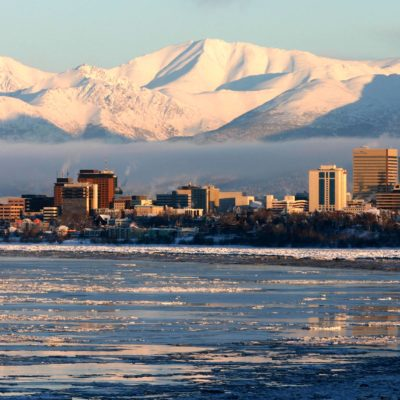Wintry cityscape of Anchorage, seen from across Knik Arm.