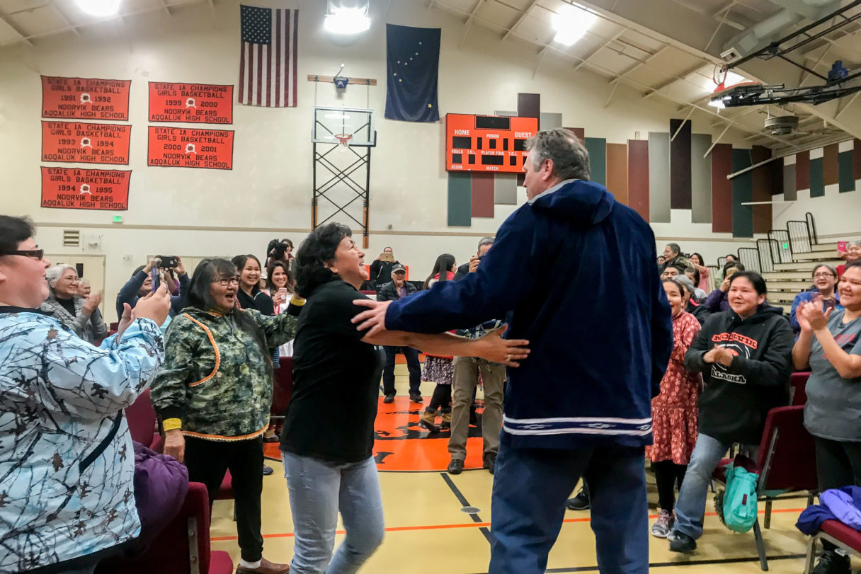 Governor Dunleavy greets residents inside the Noorvik gymnasium.