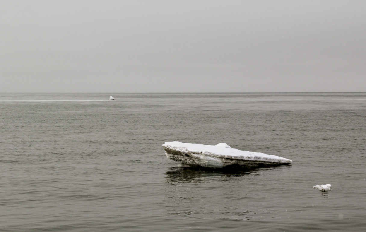 A lone iceberg floats in the Bering Sea.