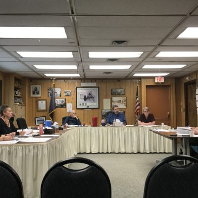 Interior of Nome City Council chambers during a meeting.