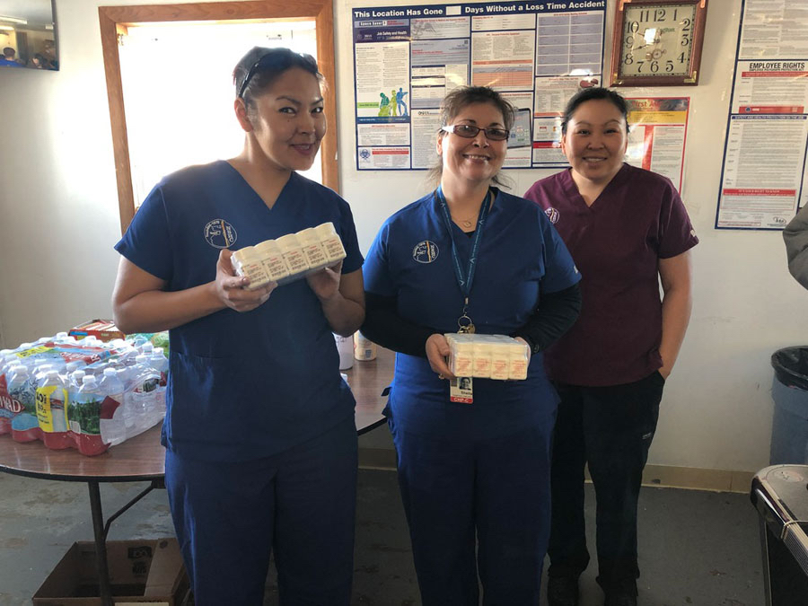 Three women wearing medical scrubs