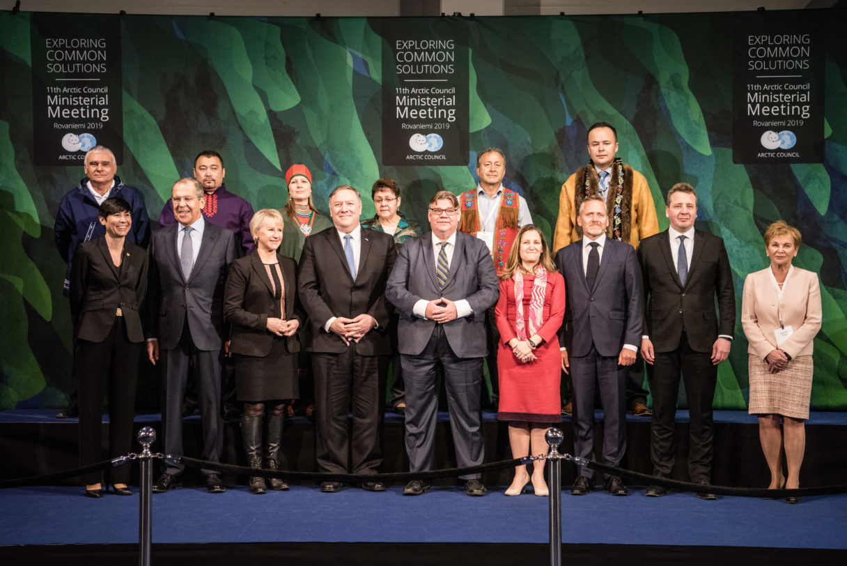Group picture of international representatives in business clothes at Arctic Council meeting