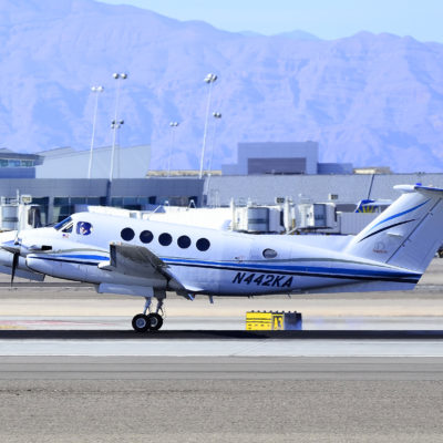A small airplane taxis at the Las Vegas airport during the daytime