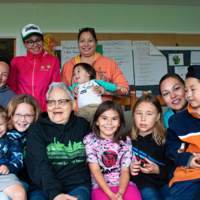 Photo of smiling family and community member in Solomon.