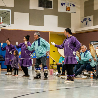 Photo of the Anchorage Kingikmiut Dancers and Singers dancing at the Kingikmiut Dance Festival in Wales.